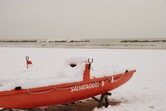 Rescue boat on the beach covered with snow Stock Photos