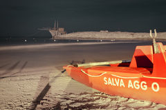 The rescue boat on the beach at night Royalty Free Stock Photography