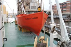 Rescue boat on board of ship S.S. Hellas Liberty in haven of Piraeus. Greece stock photos