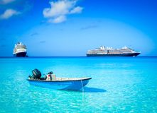 Rescue boat and cruise ships at sea Royalty Free Stock Image