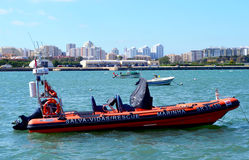 Rescue boat in Ferragudo. Harbour with portimao town as a background stock image