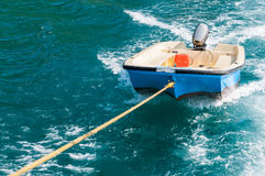 Rescue boat floating on the water. Small rescue boat floating on the water Stock Photo