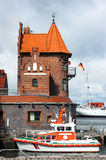 Rescue boat in front of historical brick building in Stralsund Stock Photo