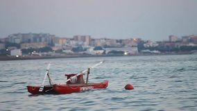 Rescue boat moored on the beach at twilight In salento - Gallipoli -Italy stock video footage