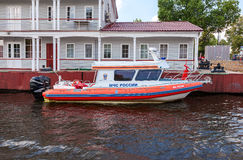 Rescue boat moored to the dock on a summer day Royalty Free Stock Image