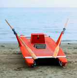 Rescue boat rowing for lifeguard on the shore of the sea Stock Images
