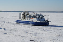 Rescue boat. Ship  winter  transportation  hovercraft  rescue  snow  cold  tree  on  river Royalty Free Stock Image
