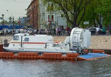 St. Petersburg, Russia - 27 Jul 2018: Rescue boat at the waterfront from the embankment in St. Petersburg, Russia royalty free stock photo