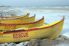 Rescue boats on frozen beach stock images