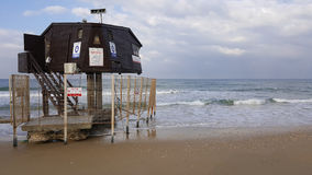 Rescue booth,  tower for lifeguards placed on the sea beach. Rescue booth,  watchtower for lifeguards placed on  Mediterranean Sea beach, beautiful sky with Stock Image