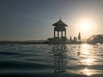 Rescue booth, tower, rescue post on the edge of the pool-infinity water merging with the horizon on the background of the sea in a royalty free stock photography
