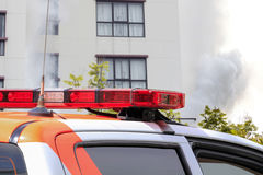 Rescue car at burning fire building. Stock Image