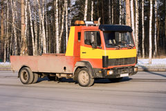 Rescue Car Carrier Truck. Red and Yellow Rescue Car Carrier Truck Stock Photography