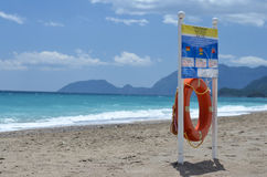 Rescue circle on beach. Sea Stock Image