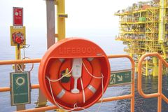 Rescue equipment. Emergency life buoy station at oil and gas platform Stock Photos