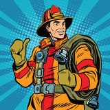 Rescue firefighter in safe helmet and uniform pop art. Retro vector. The professional rescuer Stock Photo