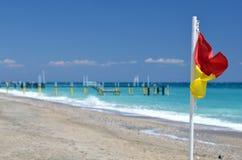 Rescue flag on beach. Sea Stock Photos