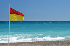 Rescue flag on beach. Sea Stock Images