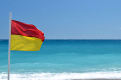 Rescue flag on beach. Sea Royalty Free Stock Photography