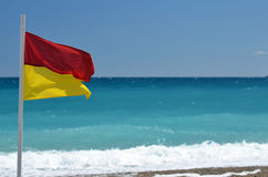 Rescue flag on beach. Sea Royalty Free Stock Images
