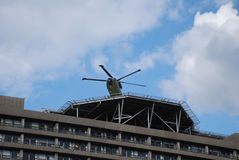 Rescue Flying. A helicopter takes off from the roof of a building Stock Photos