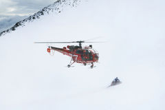 Rescue flying helicopter on background of the Alps Mountains. Rescue flying helicopter on background Royalty Free Stock Photo