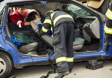 Rescue forces units saving the injured woman. Stock Photos