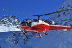 Rescue Helicopter. A Rescue helicopter coming in to land, with door already opening to deal with a mountain emergency. A doctor is inside stock image