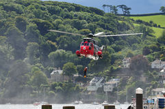 Rescue helicopter. Royal Navy sea King helicopter during a flying and recue display at the 2010 Dartmouth regatta Stock Photography