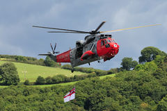 Rescue helicopter. Royal Navy sea King helicopter during a flying and recue display at the 2010 Dartmouth regatta Royalty Free Stock Image