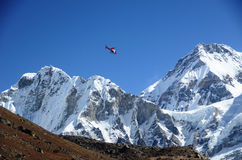 Rescue helicopter. In the Everest ridge stock photo
