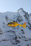 Rescue helicopter. From Austrian Mountain Rescue Service flying at accident site in Grossglockner, Austria. In 2001 the Rescue Service performed a total of 6508 stock images