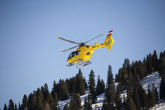 Rescue helicopter. Austrian rescue helicopter over an ski area stock images