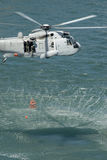 Rescue Helicopter. An Australian navy sea king helicopter practising a rescue Stock Image