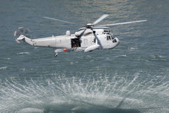 Rescue Helicopter. An Australian navy sea king helicopter practising a rescue Royalty Free Stock Image