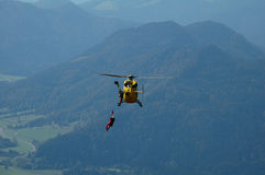 Rescue Helicopter. View of rescue helicopter over mountain forest Royalty Free Stock Images