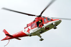 Rescue helicopter-Air Transport Slovakia. Rescue helicopter lifting injured man Stock Photography