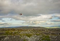 A rescue helicopter aprroaching An Grianan of Aileach, Co Donega. L royalty free stock images