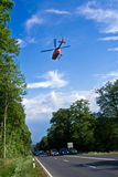 Rescue by Helicopter. BAD HOMBURG, GERMANY - May 05: Helicopter is landing on the street to save and transport a seriously insured person by car accident to Stock Photography