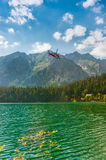 Rescue Helicopter and Beautiful Lake in High Tatra stock image