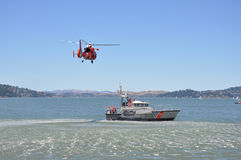 A rescue helicopter and boat Royalty Free Stock Images