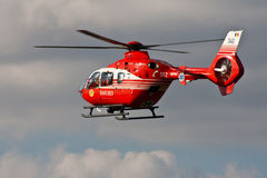 Rescue helicopter EC-135. On its way to a new 112 call Royalty Free Stock Photo
