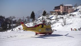 Rescue helicopter evacuates skier after accident stock footage
