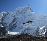 Rescue helicopter. In the Everest mountains of Nepal royalty free stock photos