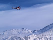 Rescue Helicopter. Flying over Tatra Mountains in Poland stock photo