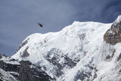 Rescue helicopter in Himalaya Mountains, view from Annapurna Bas Stock Images