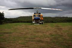 Rescue helicopter landed on a grass strip Royalty Free Stock Photos