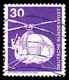 Rescue helicopter MBB, Industry and Technology Definitives 1975-1982 serie, circa 1975. MOSCOW, RUSSIA - FEBRUARY 10, 2019: A stamp printed in Germany, Federal royalty free stock image