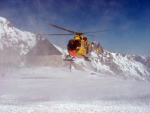 Rescue helicopter in the mountains Stock Photo