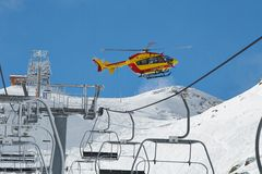 Rescue helicopter in the mountains Royalty Free Stock Image